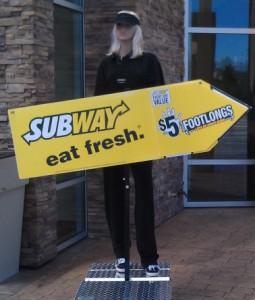 sign swinging mannequin